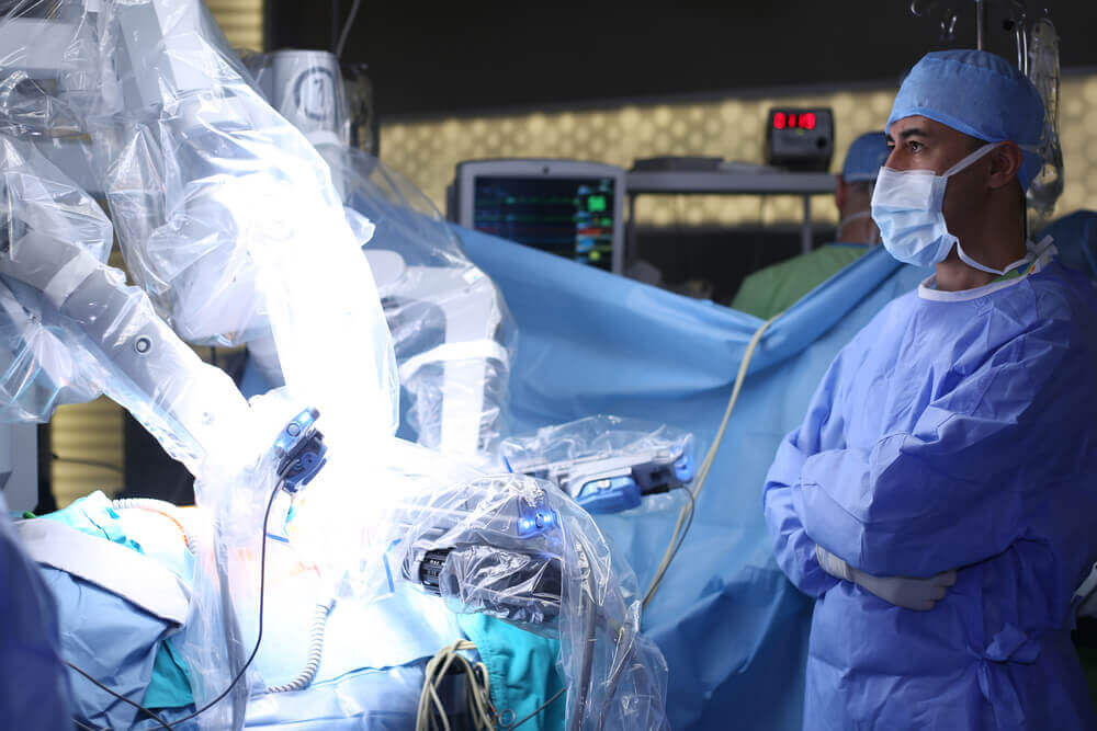 Surgeon Being Assisted by Robotic Arm During Surgery