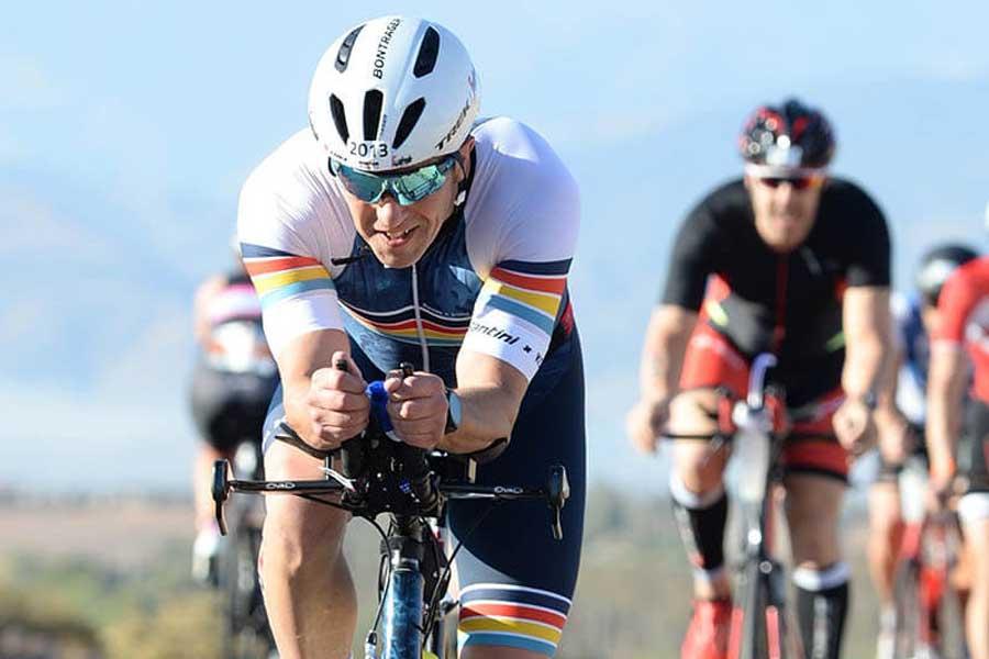 Kevin Heath cycling in a triathlon