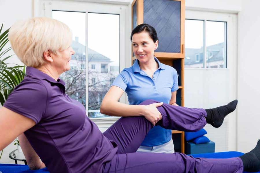 Physiotherapist Working on Patient's Knee