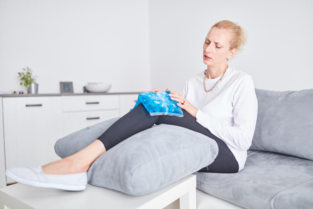Lady Holding Ice Pack on Injured Knee