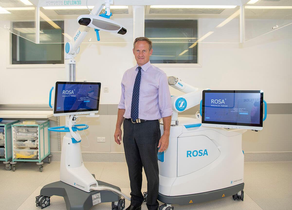 Nick London Stood with ROSA Robot